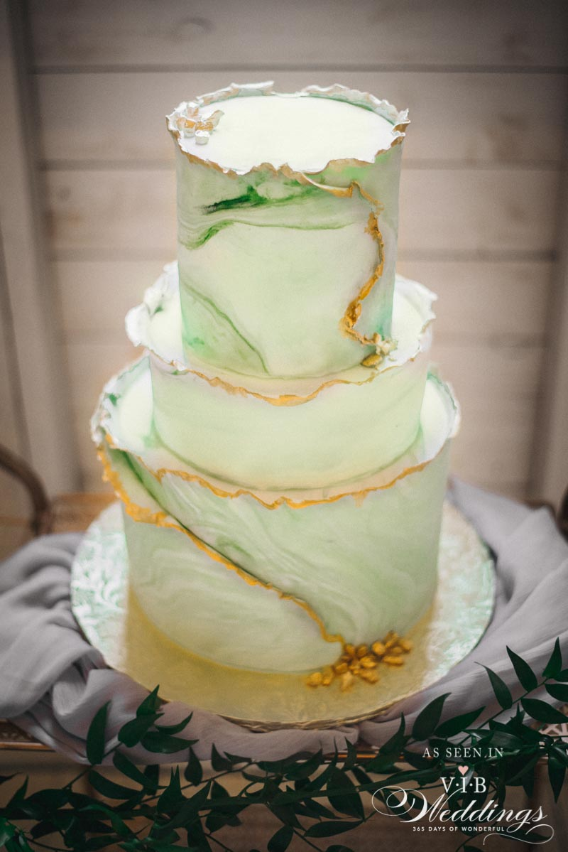 Marbled green cake with gold edging by High Tea Bakery